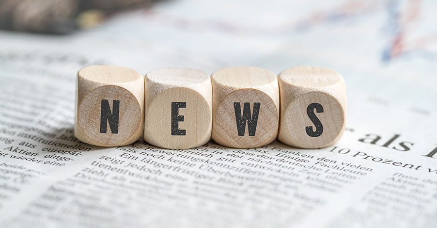 """cubes with the word """"news"""" on a newspaper"""